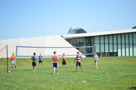 Students are playing volleyball together in last year