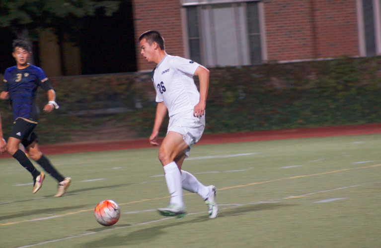 First-year midfielder Brian Woo looks to evade Kenyon defenders during the Spartans upset victory.