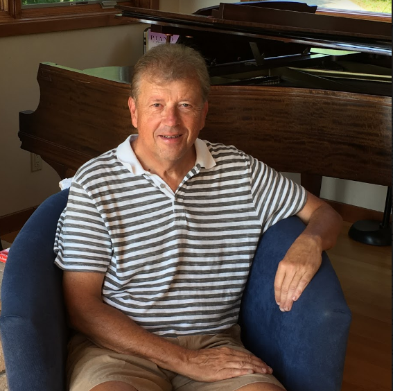 Dr. Gary Ciepluch sits on a couch of his Wisconsin lake house, where he will move permenantly after his retirement.
