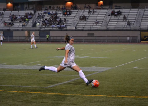 Fourth-year forward Jennifer Zajic (right) emphatically strikes the ball during a Spartans free kick.