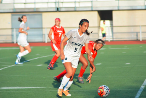 Forward Kimberly Chen keeps her eye on the ball as she receives a pass during an early season match.
