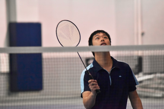 Will Chen searches for the shuttlecock as he waits to return a serve.