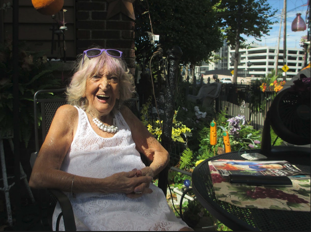 As Fiorelli sits by her garden each day, people approach her to compliment the colorful spot on an otherwise brick-and-concrete street.