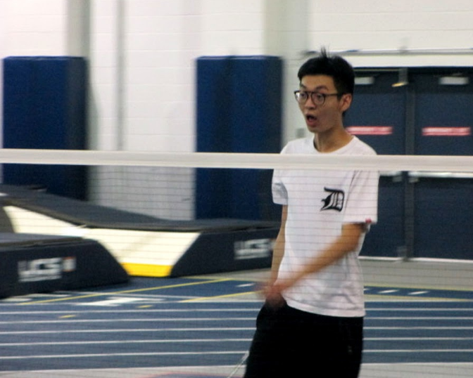 A member of the Badminton Club shows a lot of excitement after winning a point during a match versus Oberlin College.