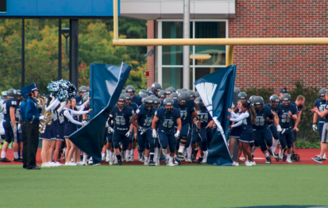 The Spartans burst onto the field before their home game versus St. Vincent College earlier in the season.