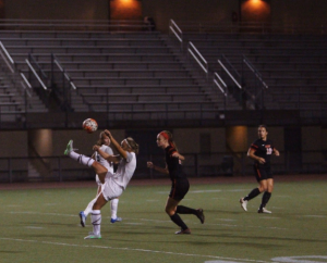 Stretching her leg high in the air, fourth-year Amy Lindberg tries to corral the ball in the middle of the pitch.