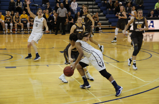 McConico drives past a Yellow Jacket defender. The Spartans lost the game by five points.