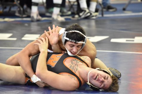 In the process of demoralizing his opponent, Mike Petersen is looking for the pin. The wrestling team travels to Wheaton College for the Pete Willson Invitational this weekend.