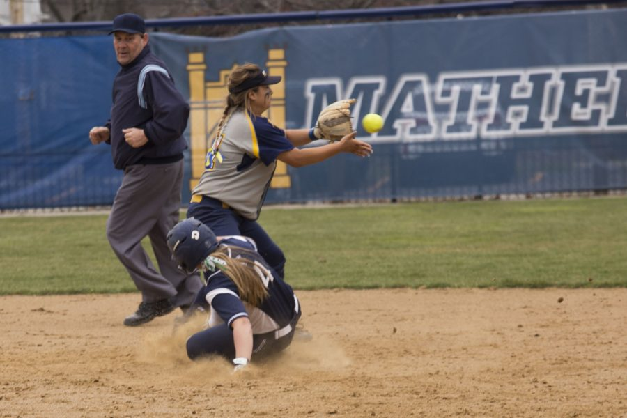 Nicole+Doyle+slides+safely+into+second+base+during+the+Spartans%E2%80%99+game+against+Emory+University.+%0A