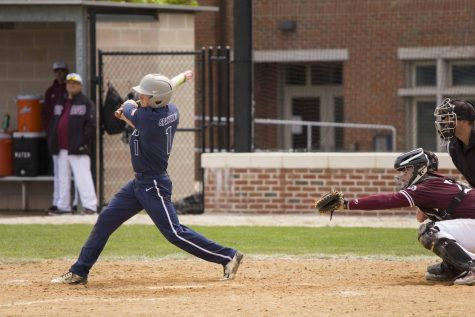 Fourth-year center fielder Aaron Cain hits a line drive against the University of Chicago. The Spartans leadoff hitter finished with nine hits in the four game series.
