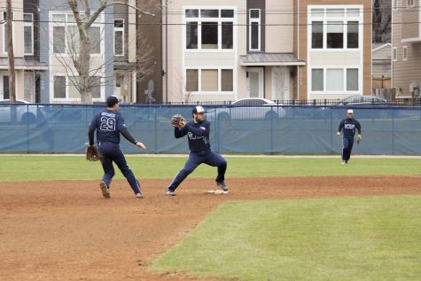 Second baseman Alex Capetillo and shortstop Rocco Maue turn two during a recent Spartans game.