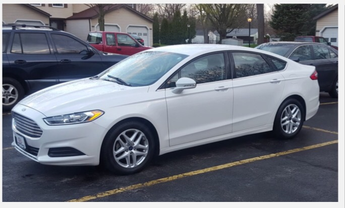 A Ford Fusion, similar to that driven by the suspect, Steve Stephens. The vehicle's temporary tag number is E363630. Stephens is 6'1, weighs 244 pounds and bald with a full beard. He was seen wearing a dark blue and grey or black striped polo shirt.