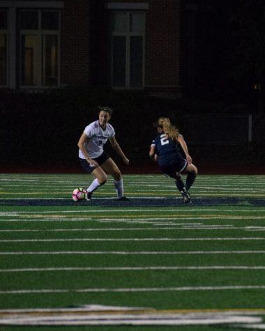 First-year midfielder Lauren LaPointe tries to dribble around a defender.