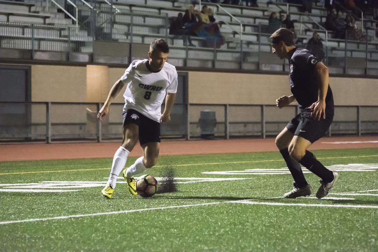 Alex Keller-Biehl attempts to outmaneuver a defender.