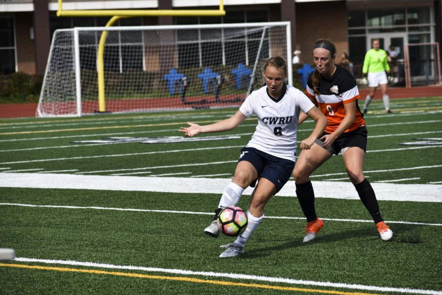 Midfielder and forward Melanie Kukura attempts to navigate around a defender earlier this season.