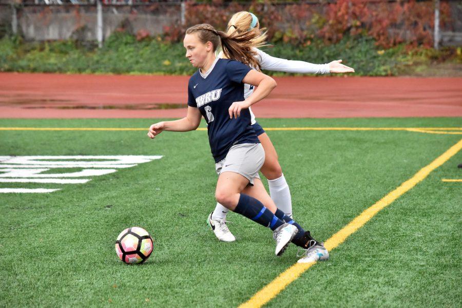 Third-year midfielder and forward Melanie Kukura goes around a flabbergasted defender.