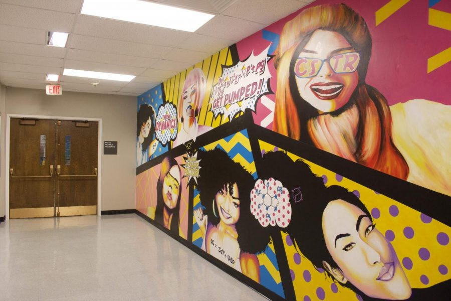 The brightly colored mural in A.W. Smith depicts the faces of six women, interspersed with chemical engineering jokes and equations.
