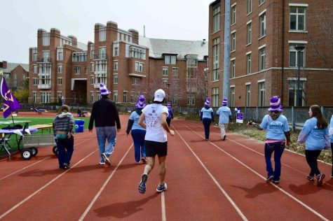 Rakuten Overdrive employees and other participants of Relay for Life walk on the Bill Sudeck Track to fundraise for cancer research.