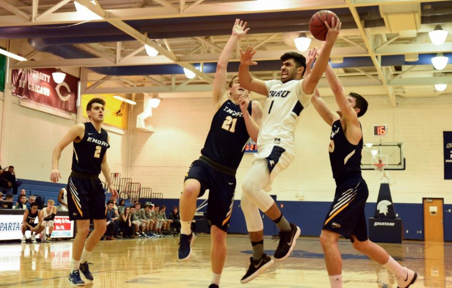 Third-year guard Monty Khela heads towards the basket. The Spartans faced Emory University and University of Rochester last weekend, ultimately falling to both.