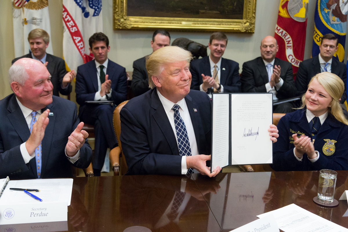 President Donald Trump displays the signed Executive Order promoting Agriculture and Rural Prosperity in America during a roundtable with farmers and agricultural commissioners in the Roosevelt Room of the White House in Washington, D.C., Tuesday, April 25, 2017. (Official White House Photo by Shealah Craighead)