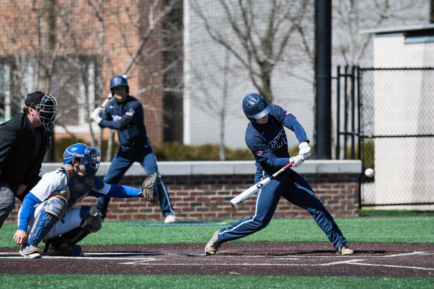 Jake Ryan swings at a pitch. Ryan was named a UAA Hitter of the Week after finishing the week batting .556 with five runs scored, one double, three home runs and five RBIs.