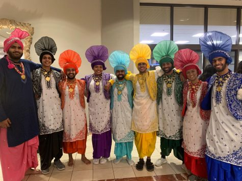 CWRU Bhangra poses for a photo in their traditional dance costumes