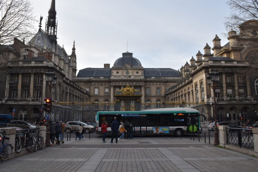 RATP Bus 21 Passes in Front of Palais de Justice de Paris. The lack of trains from the strike has left Parisian busses crowded and running off schedule as the system grapples with the longest metro strike in french history.