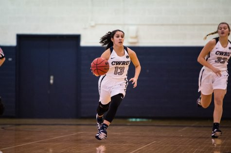 Alicia Marie Gonzales, dribbles the ball up the court against Juanita College, who CWRU beat 70-46 after a rough first quarter