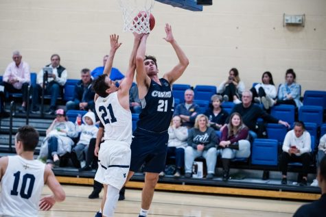 Ryan Newton goes for a layup against JCU.