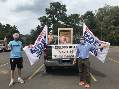 (From left to right) Tom Moran, Robert Davidson and Ward Lindsay show off their homemade diorama of Donald Trump's head.
