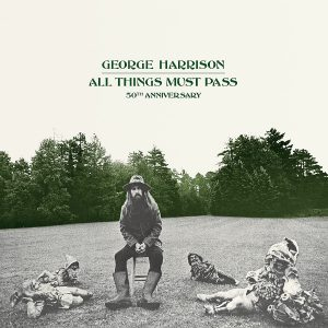 George Harrison poses with four gnomes, widely interpreted to represent the breakup of the Beatles, as he moves on with his new masterpiece.
