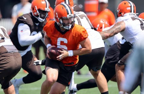 Cleveland Browns quarterback Baker Mayfield practices with the offensive squad at training camp.