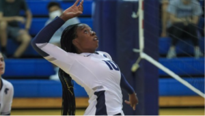 Second-year Jennfier Ngo spikes the ball over the net, recording eight total kills on Wednesday night.