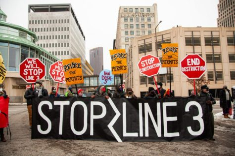 Protesters campaigning to stop Line 3, a tar pipeline currently under construction in northern Minnesota threatening over 200 bodies of water, as well as Native American territory.
