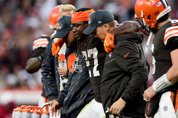 Injured Browns running back Kareem Hunt is escorted off the field, adding to the growing list of key players sidelined due to injury.