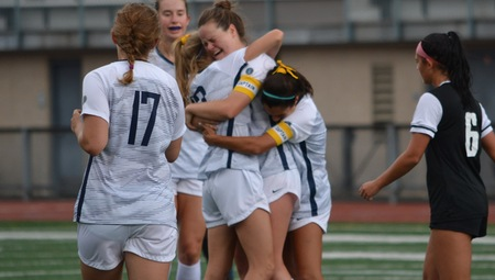 The CWRU womens soccer team embraces as they kick off the fall season with two wins.